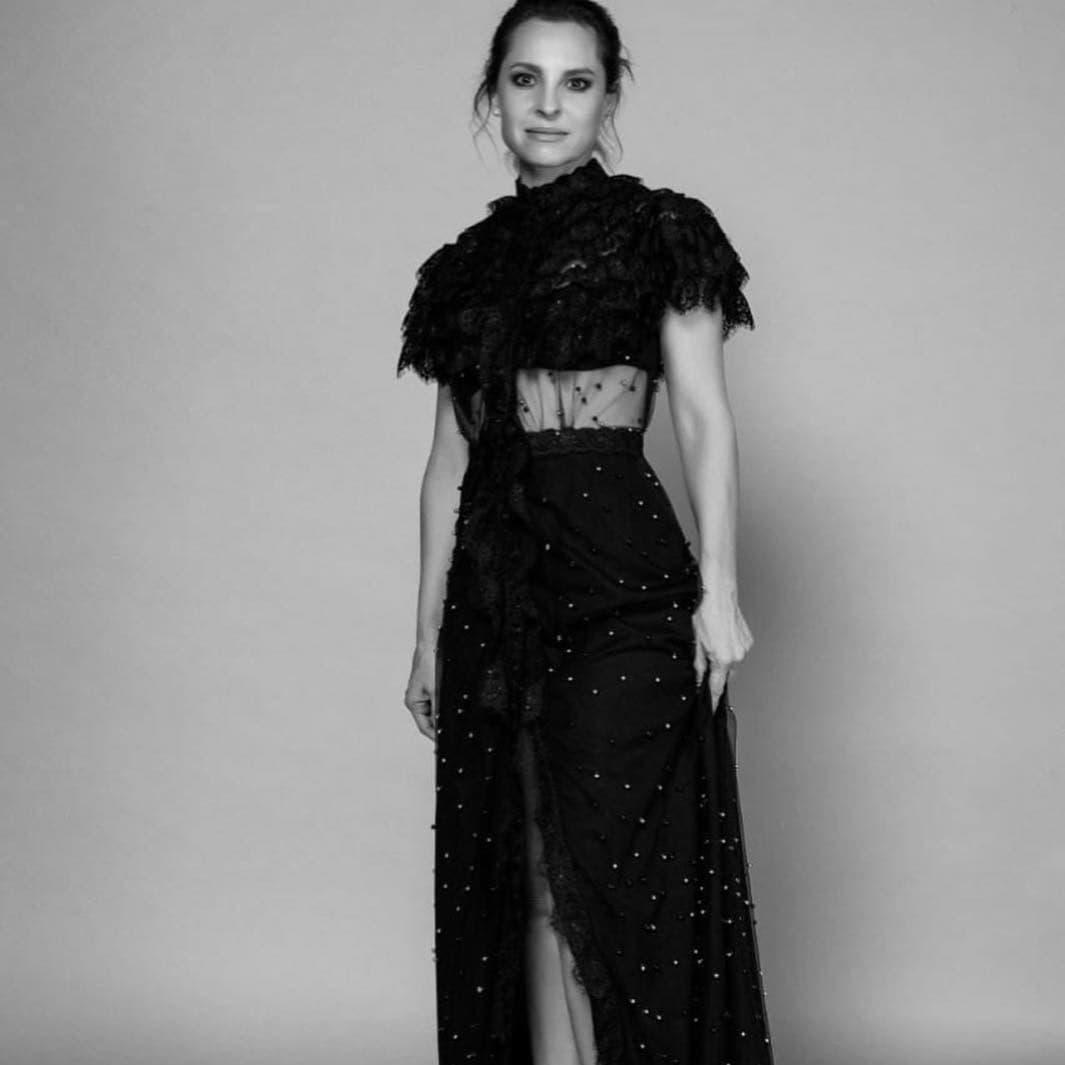 Marina de Tavira in session with a fabulous black dress.